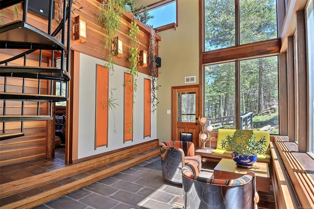 Midcentury meets mountain lodge in this Colorado pad asking $739K