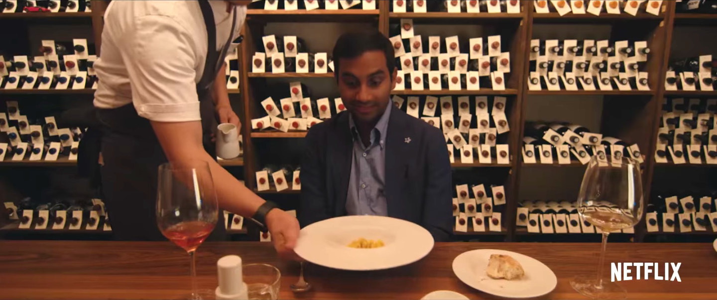Aziz Ansari served a plate of food in Master of None