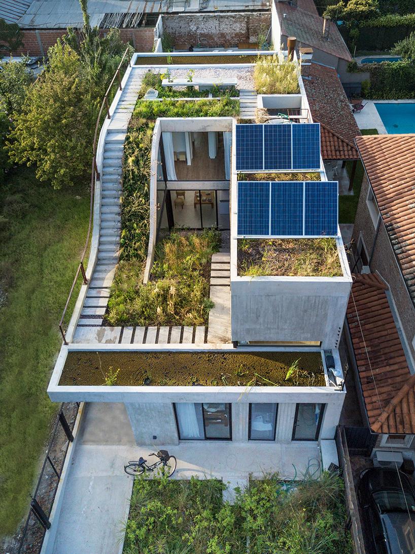 Solar-powered modern home has gardens on every floor