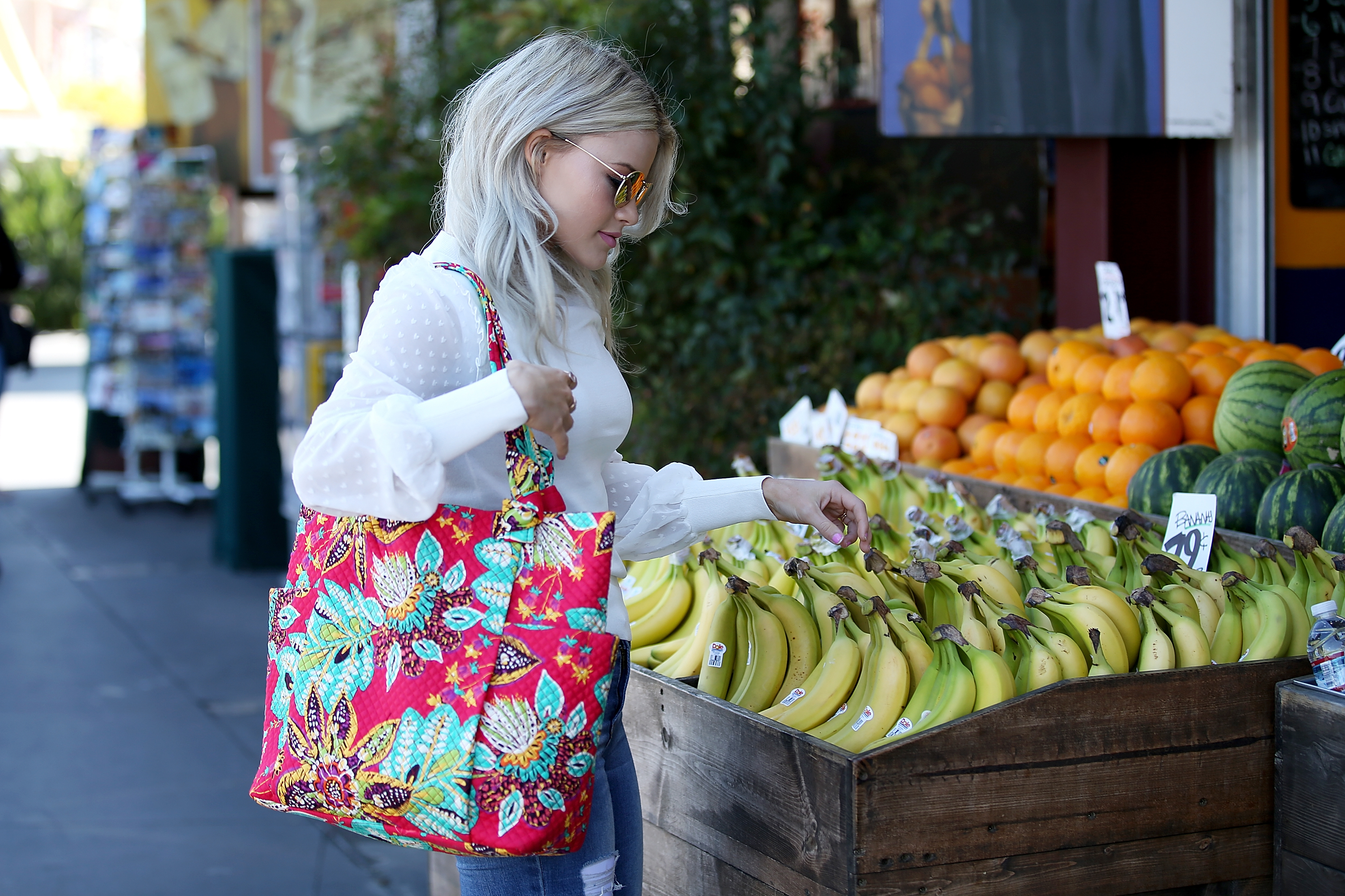 Woman shopping with Vera Bradley tote