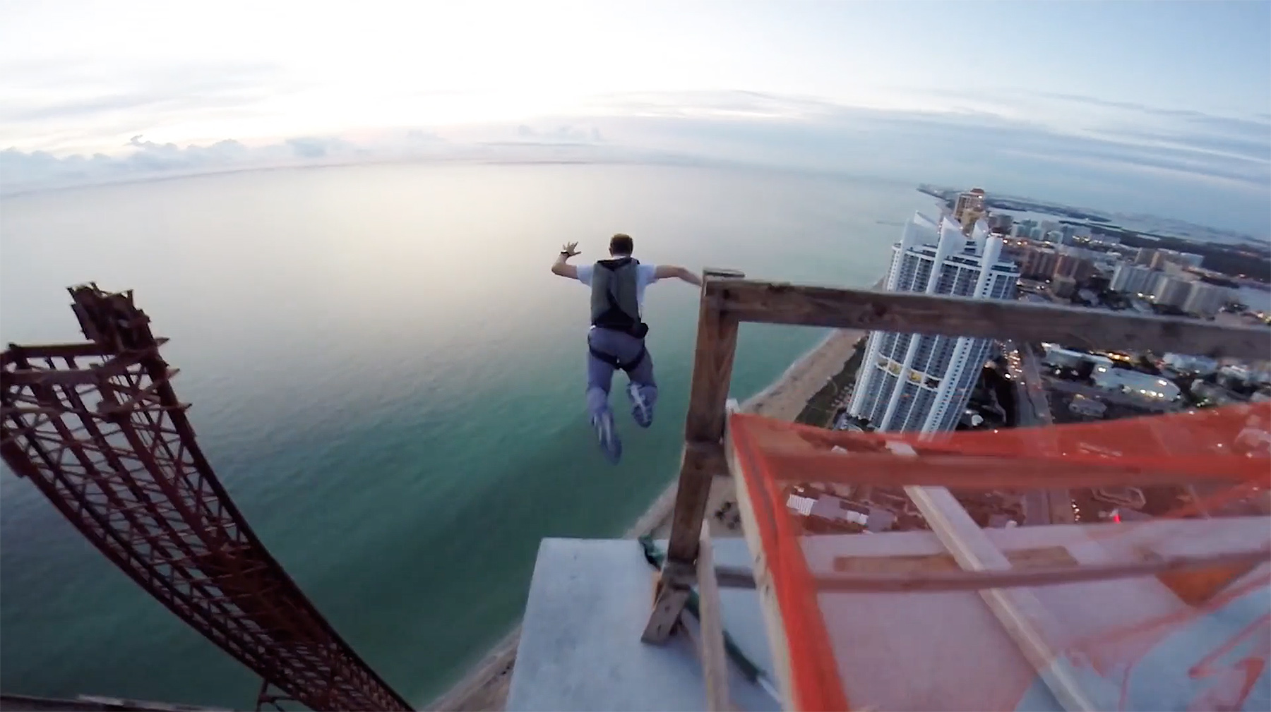 A crazy person launching off the roof of the Porsche Design Tower in Sunny Isles Beach