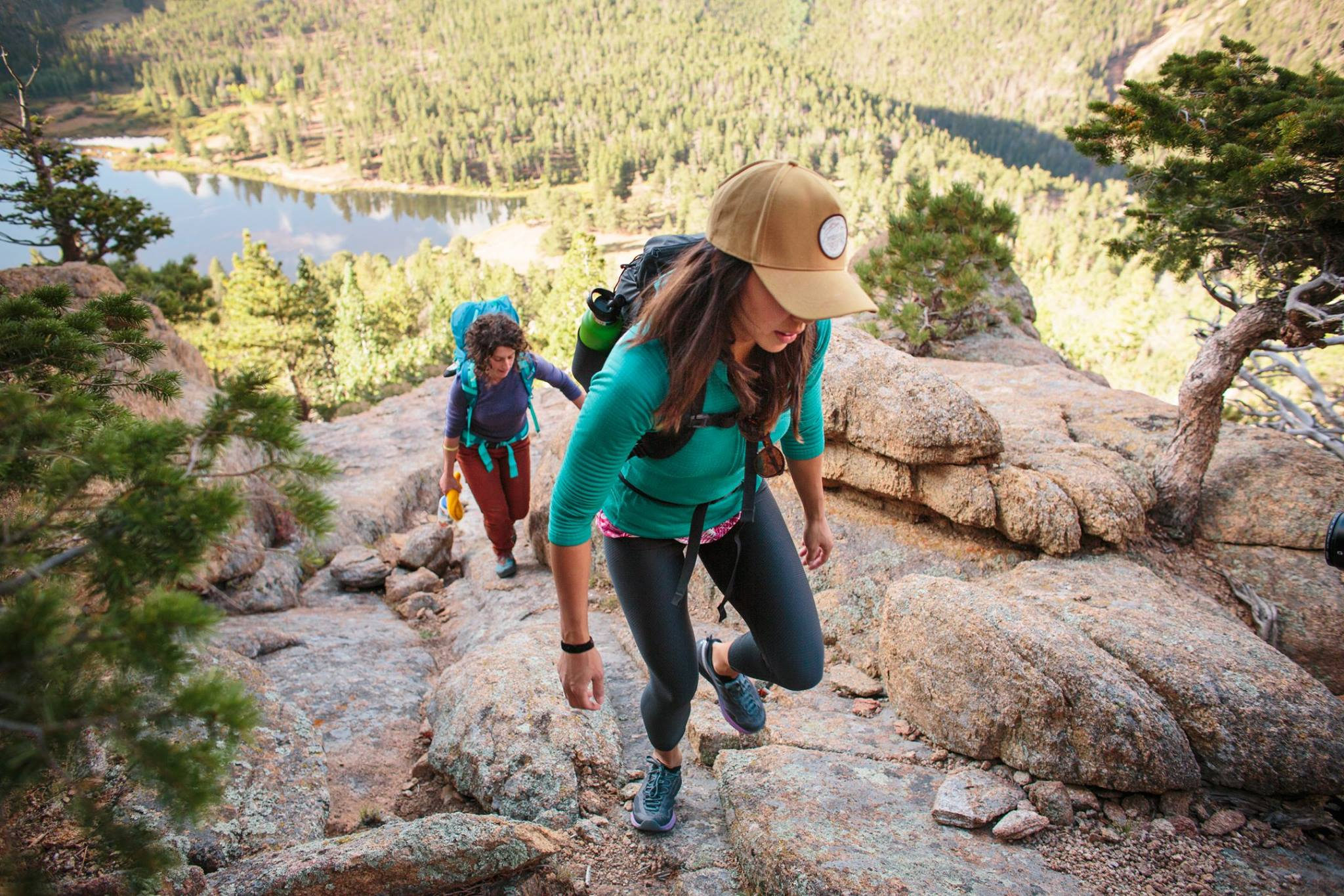 Two women hiking with backpacks on