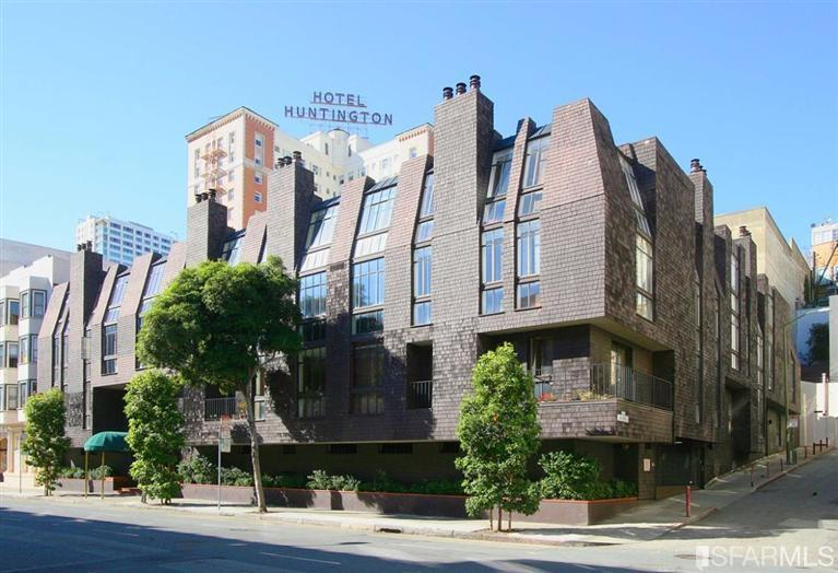 A short Nob Hill building with a shingled exterior.