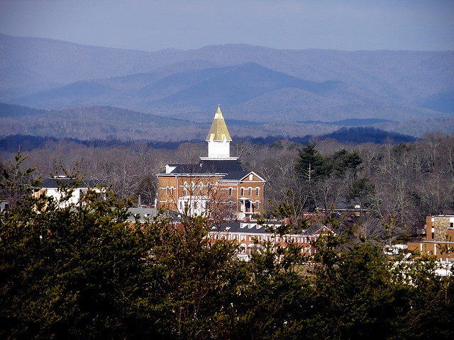 A picture of Price Memorial Hall and the mountain vistas of Dahlonega.
