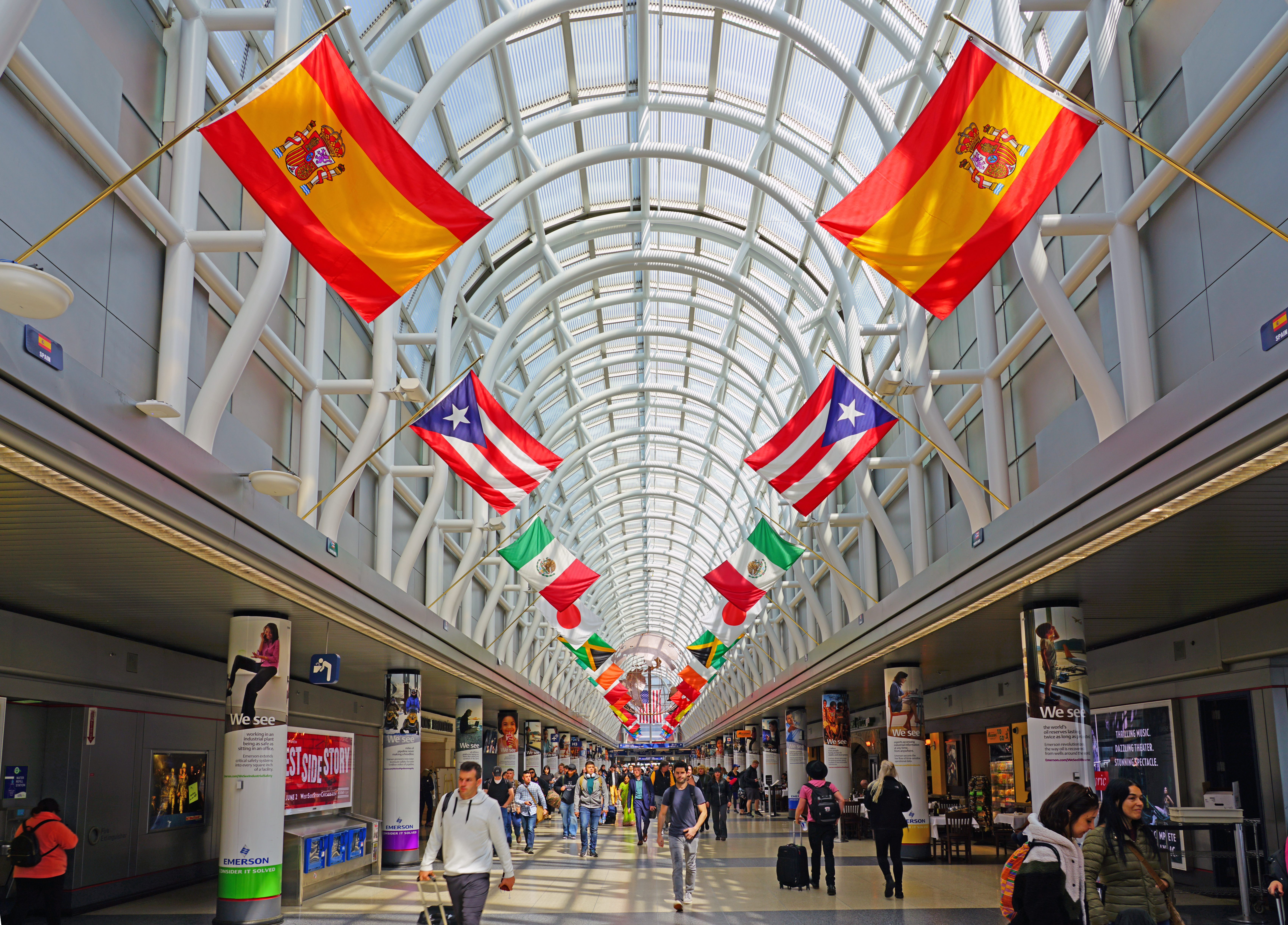A concourse inside O'Hare International Airport decorated with foreign flags.