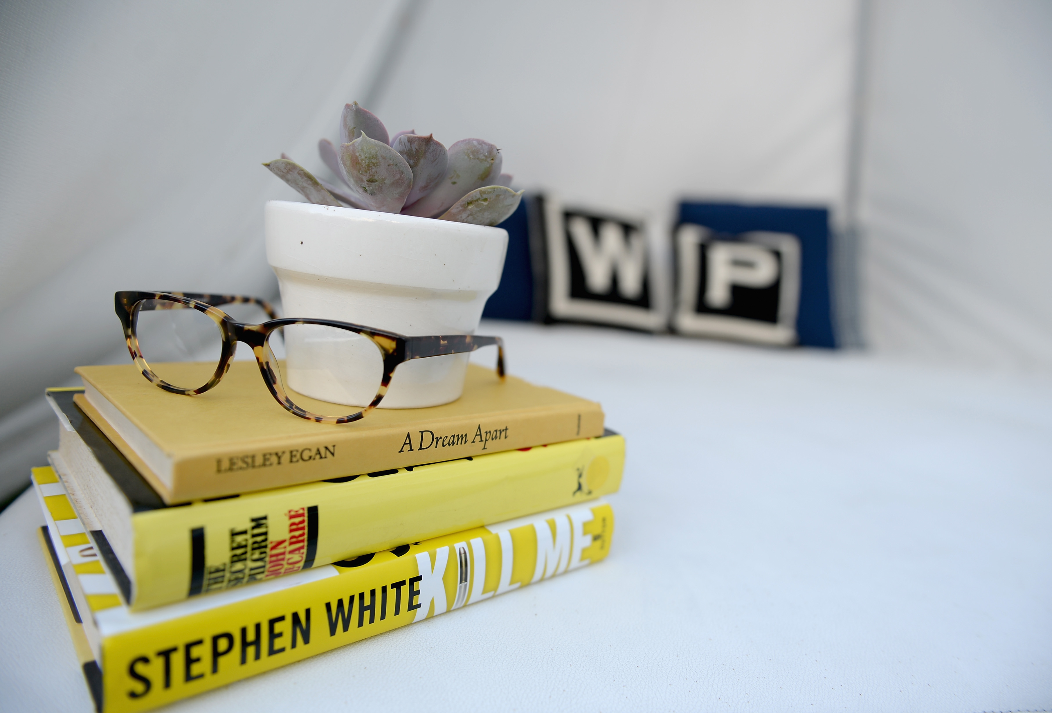 Warby Parker glasses resting on books