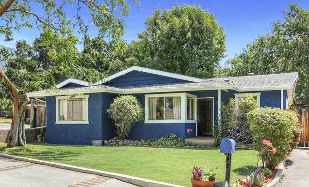 Blue house with grassy front lawn