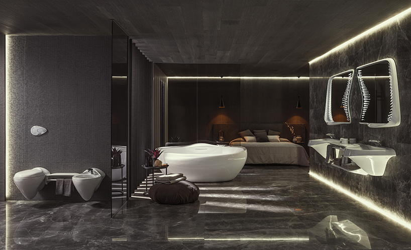 Interior shot of dark bathroom with curving, white fixtures.