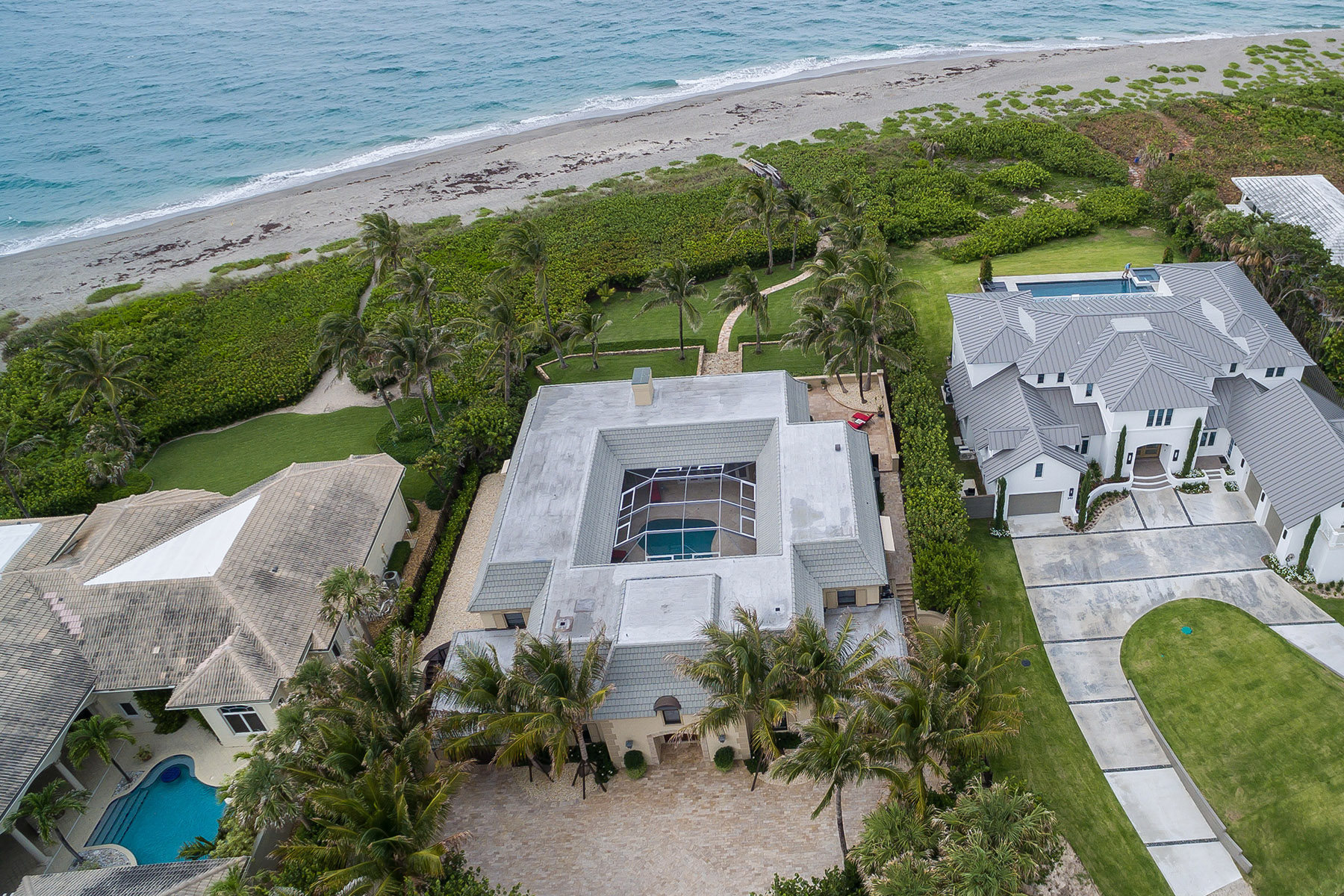 An oceanfront home in Jupiter with the beach in the background