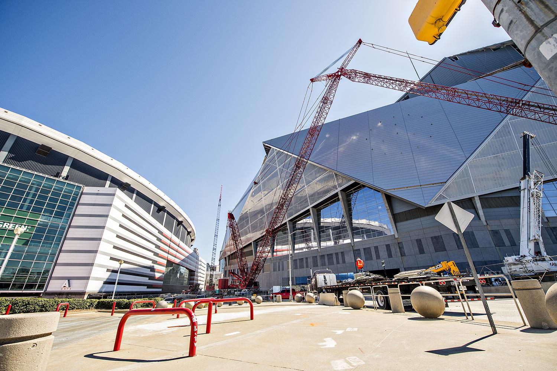 A photo of Mercedes-Benz Stadium next to the Georgia Dome.