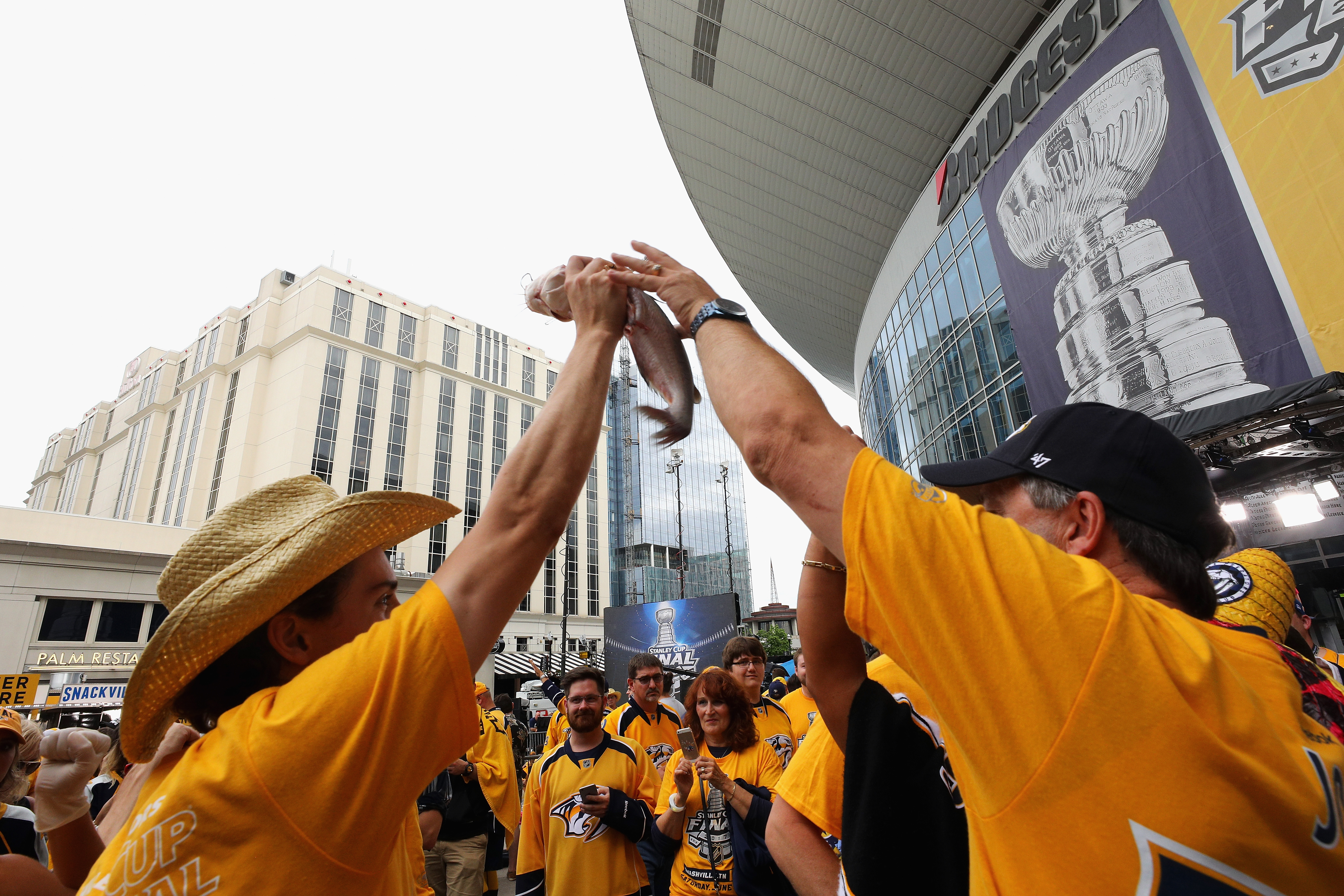 Nashville Predators fans cheer with a catfish prior to in Game Four of the 2017 NHL Stanley Cup Final.