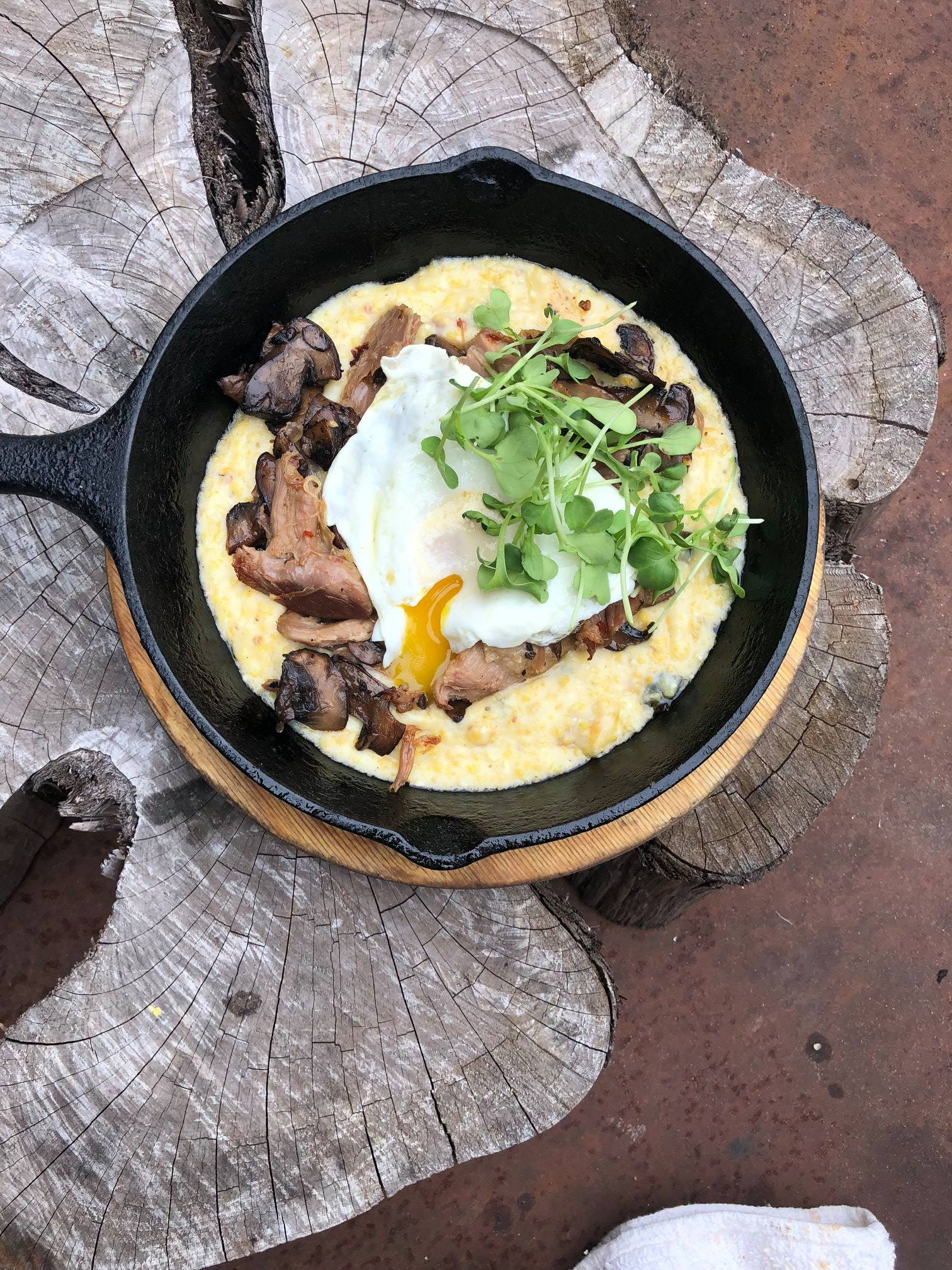 Duck confit, duck eggs, mushrooms, and grits from the Leaning Pear