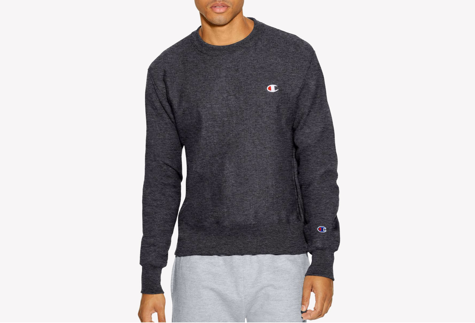 A male model wearing a dark gray Champion sweatshirt