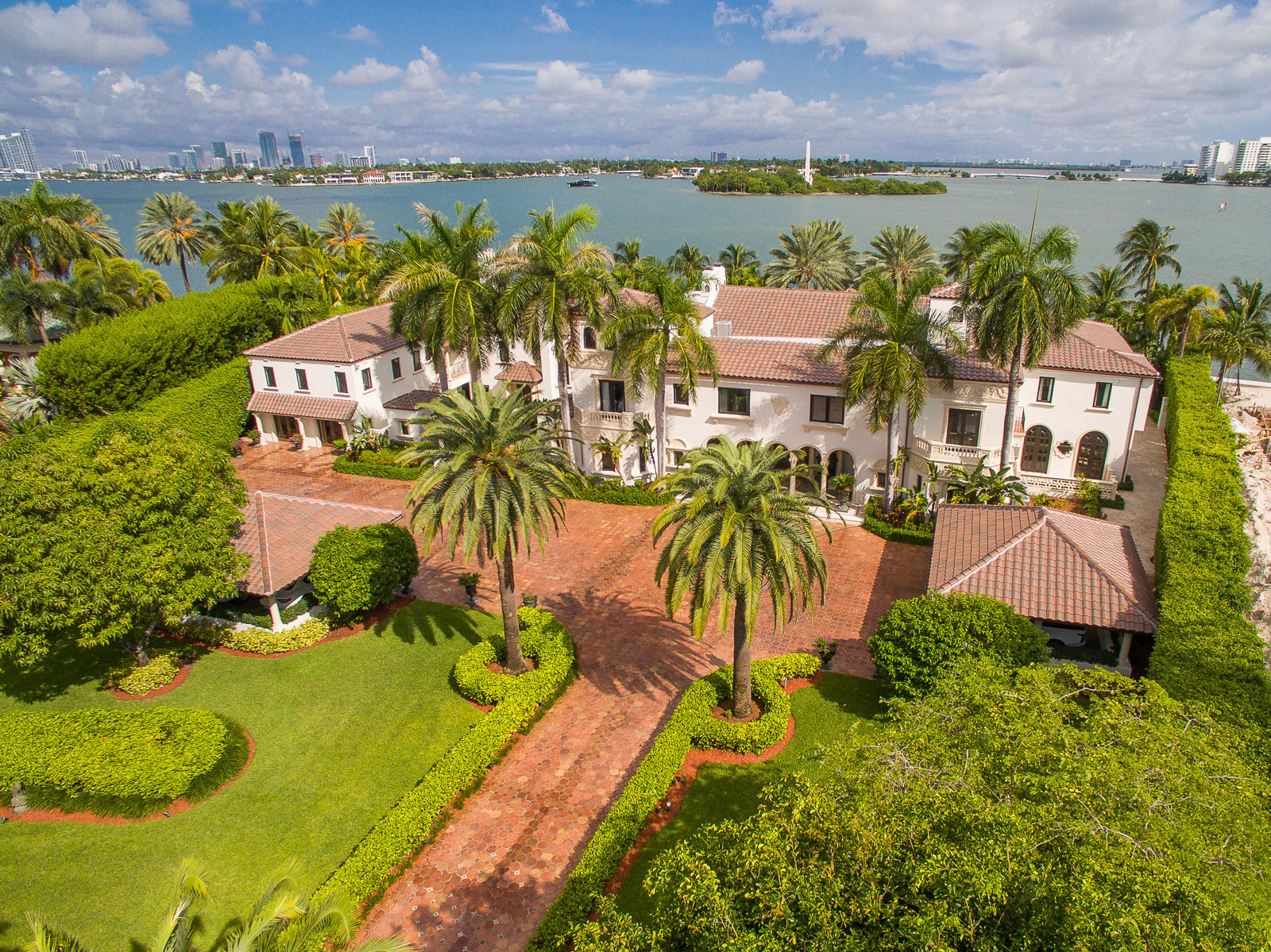 A $65 million home for sale on Star Island showing the bay behind the home