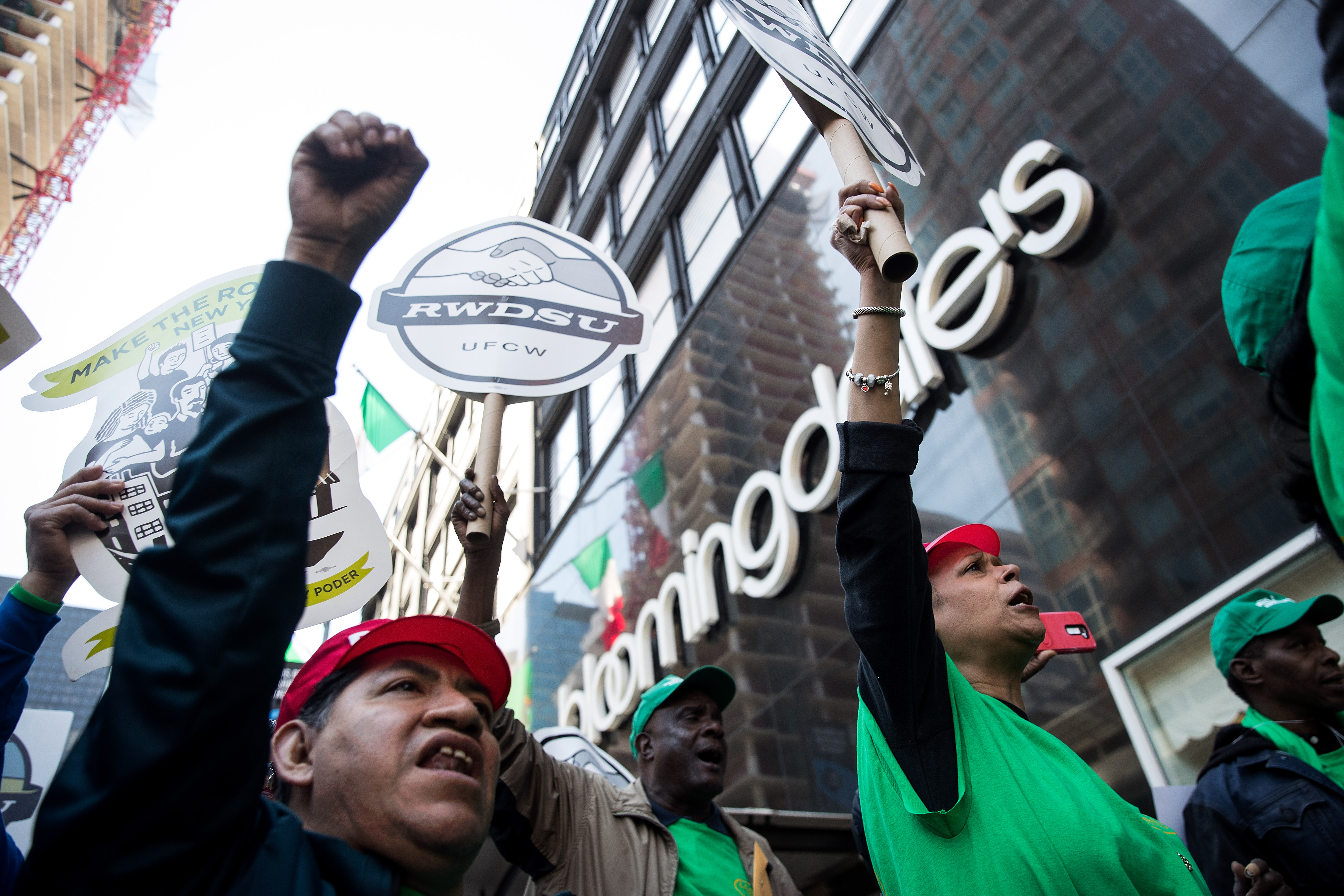 An April 2017 rally held by unionized Bloomindale's workers in New York City in April. Workers hold signs and pump their fists outside the store flagship.