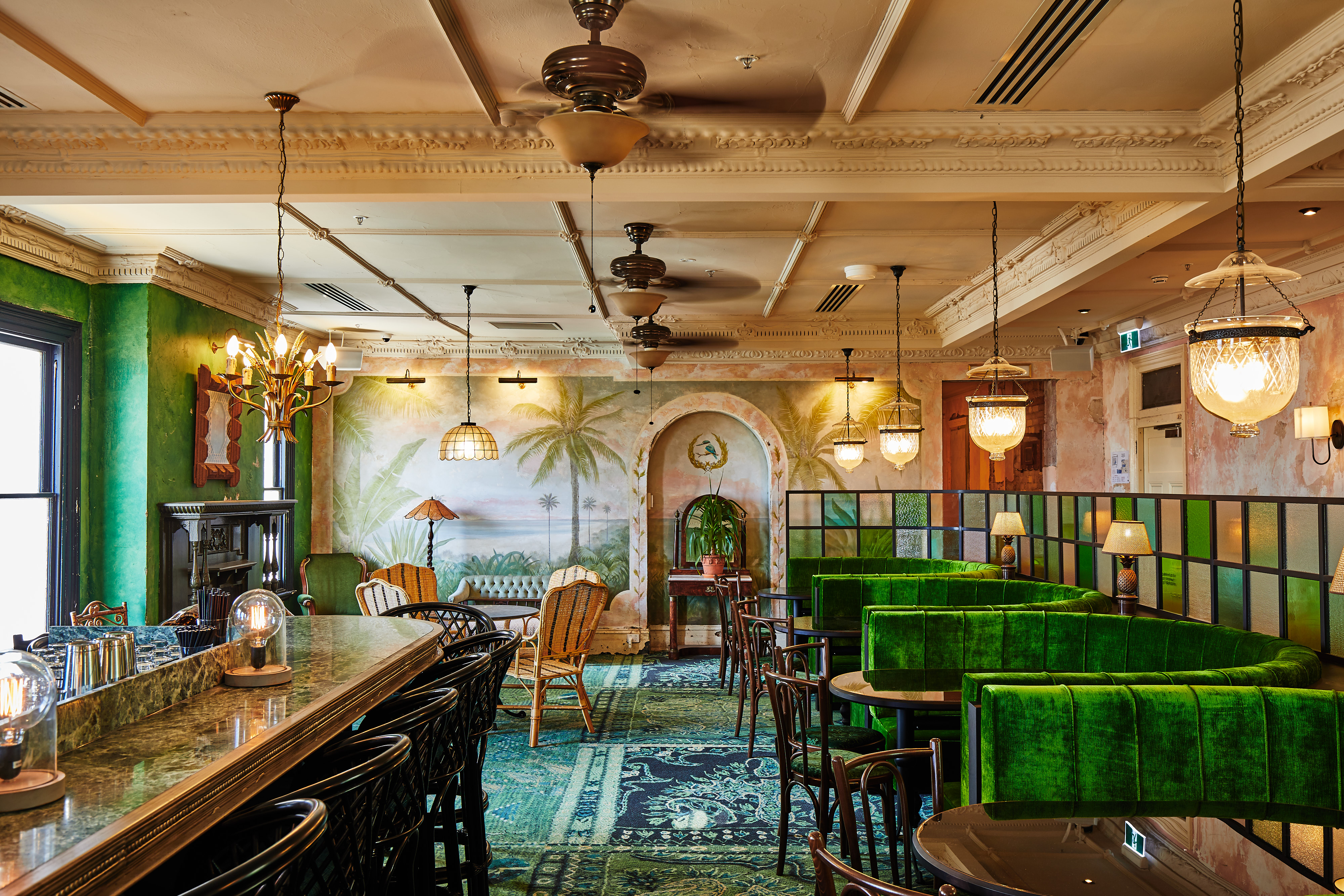 Green velvet banquettes and a vintage bar at the Espy