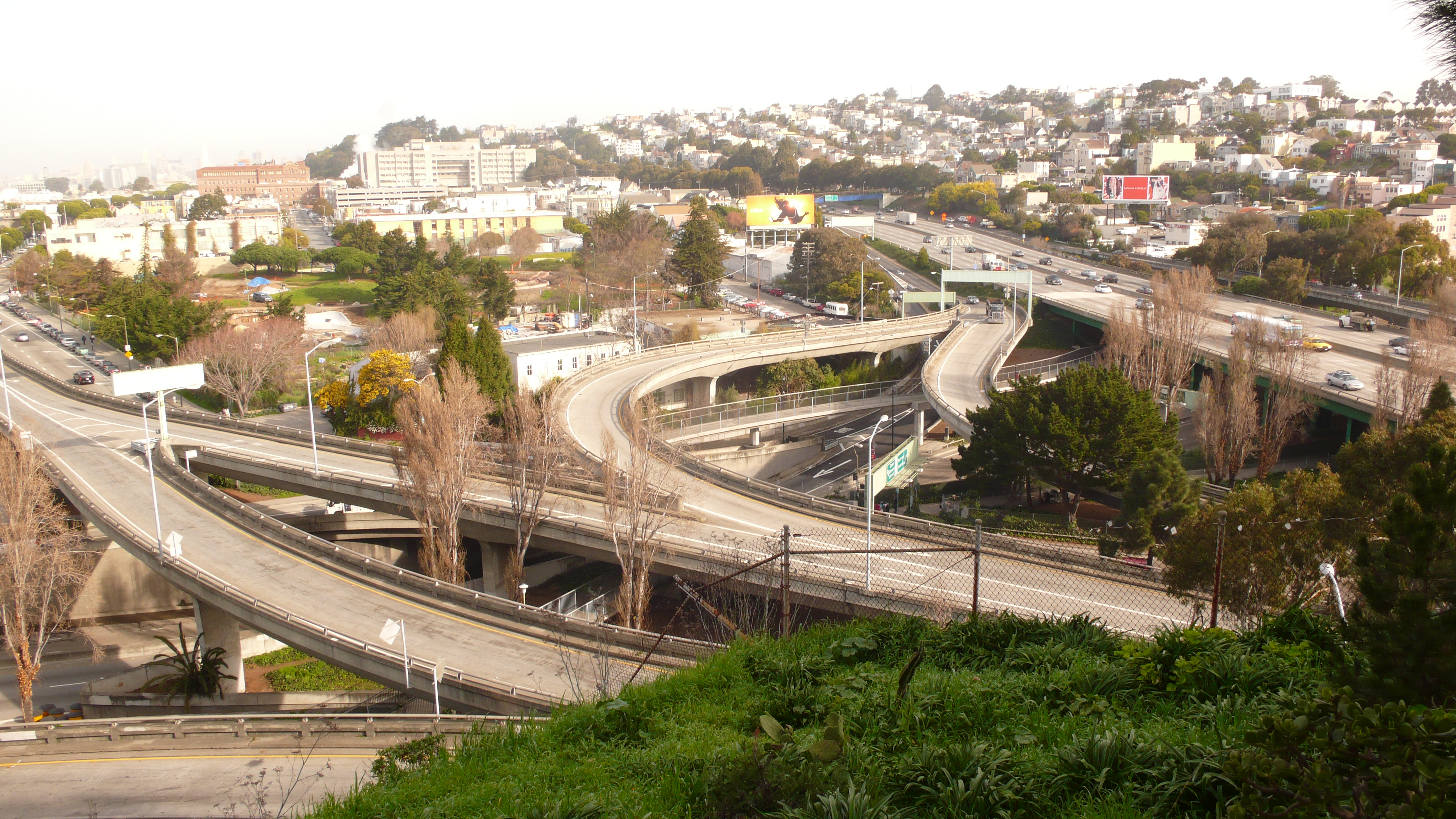 A aerial photo of the tangled freeway and bridge network around Cesar Chavez Street.