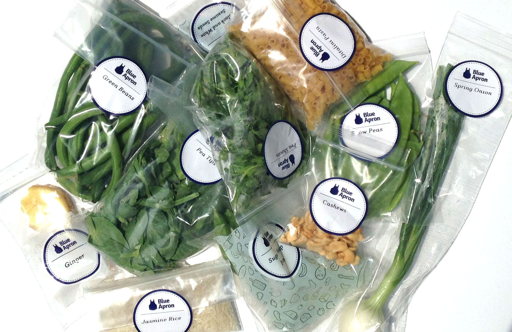Blue Apron ingredients in bags.
