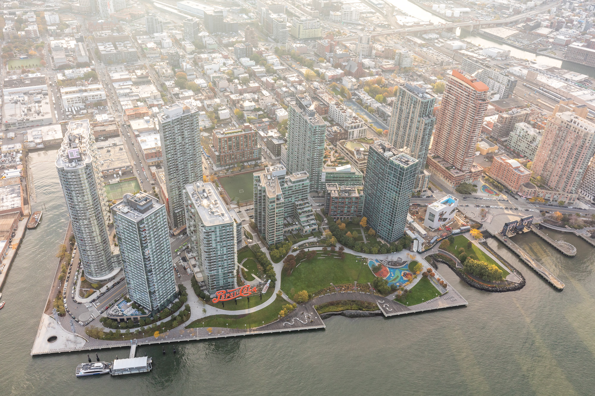 An aerial view of the tall skyscrapers that are on the waterfront in Long Island City, New York City.