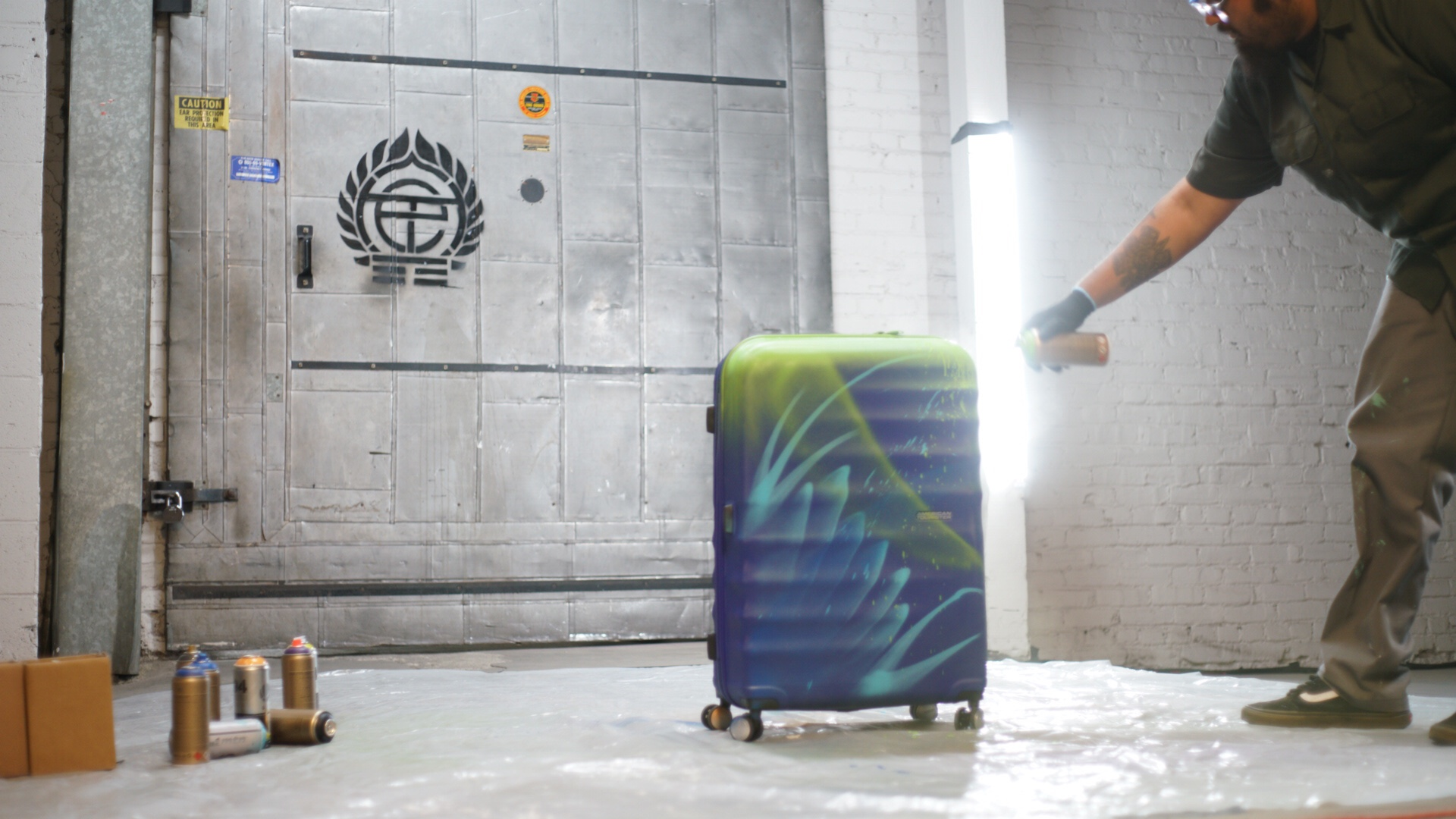 Artist Who Paints American Tourister Luggage