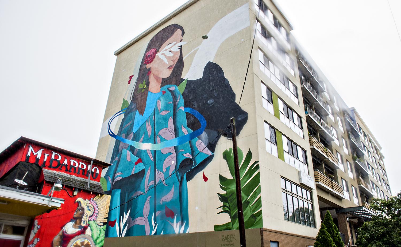 A fresh, multi-story mural by Spanish artist Sabek.