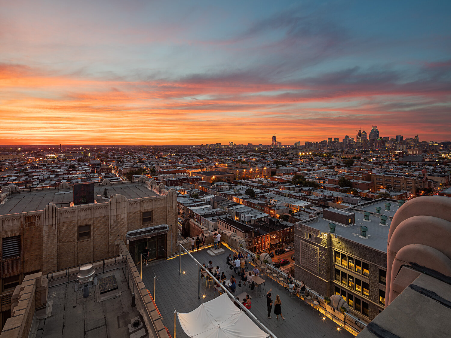 rooftop bar in city with skyline and sunset