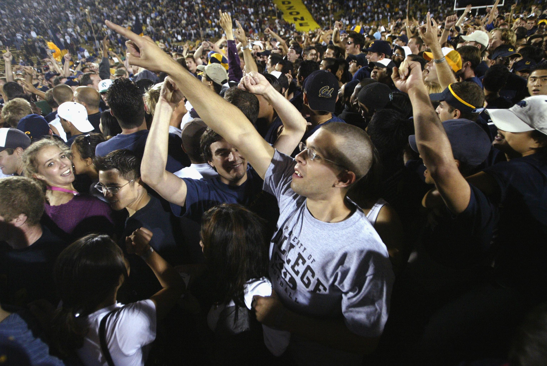 Cal fans celebrate OT win on the field
