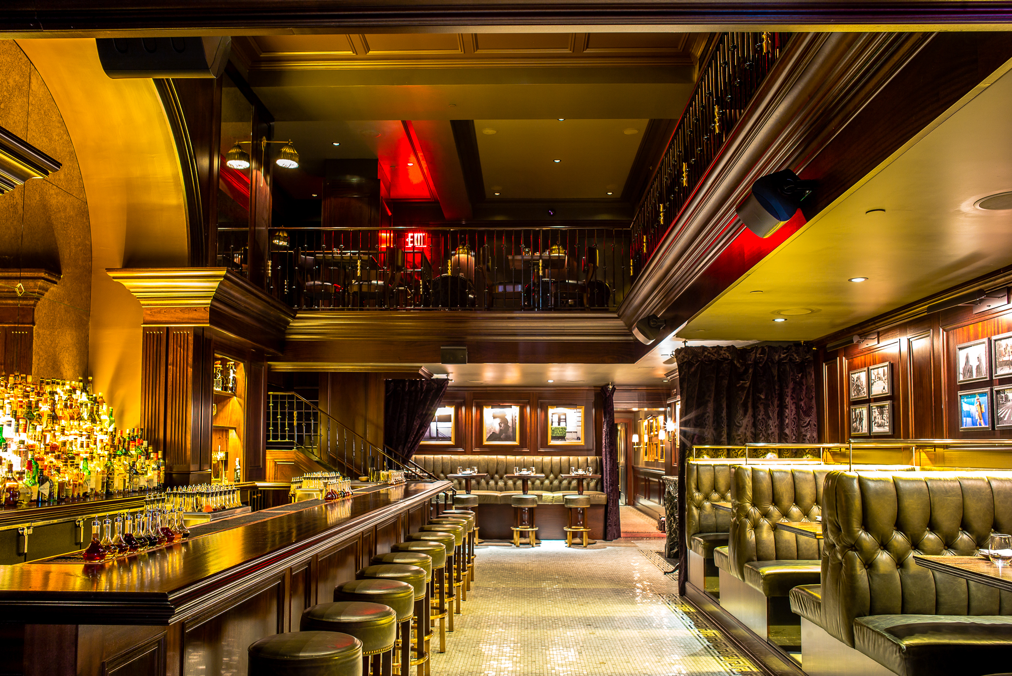 Nomad Bar, with a big bar to the left and booth seating to the right