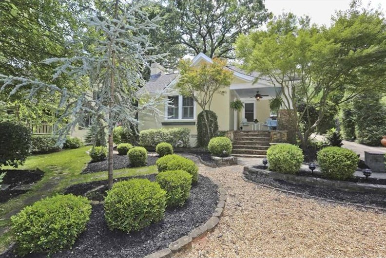 An East Lake bungalow with a nicely landscaped front yard.