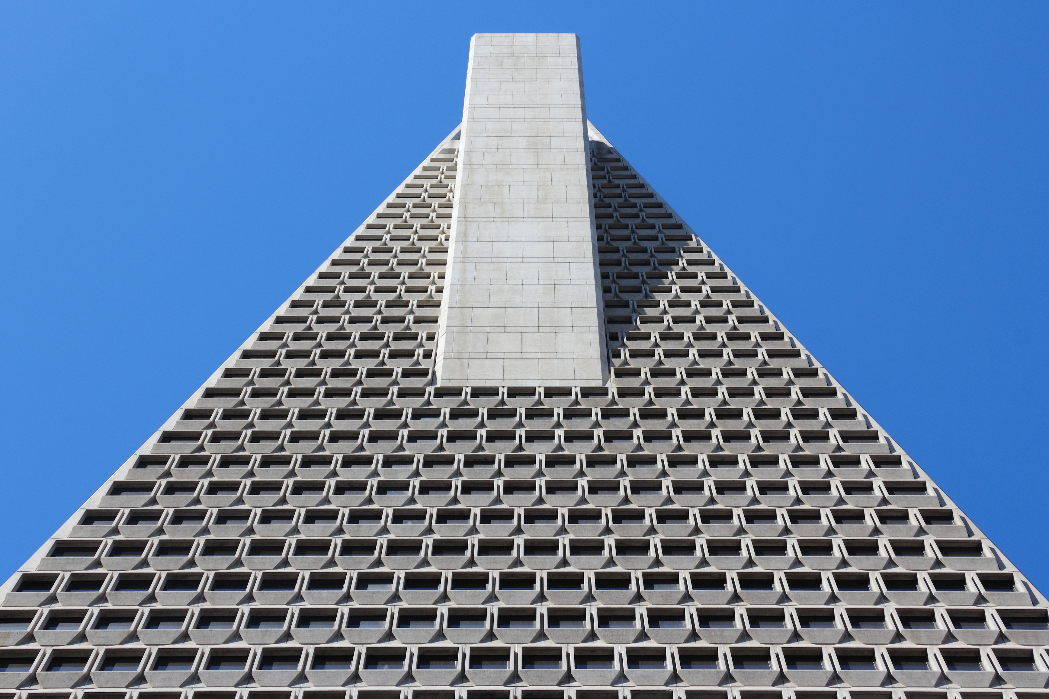 The exterior of the top of a skyscraper in San Francisco. The facade has a geometric pattern.