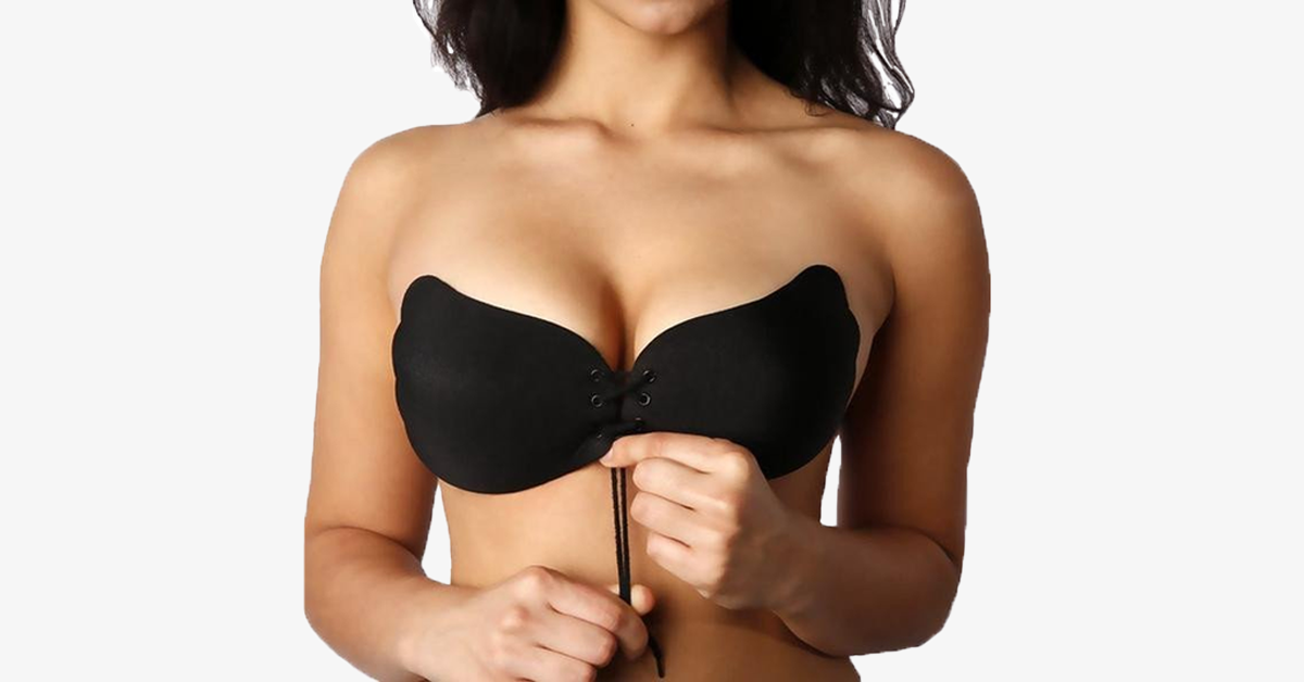 A model wearing a strapless bra, pulling at a center chord for cleavage