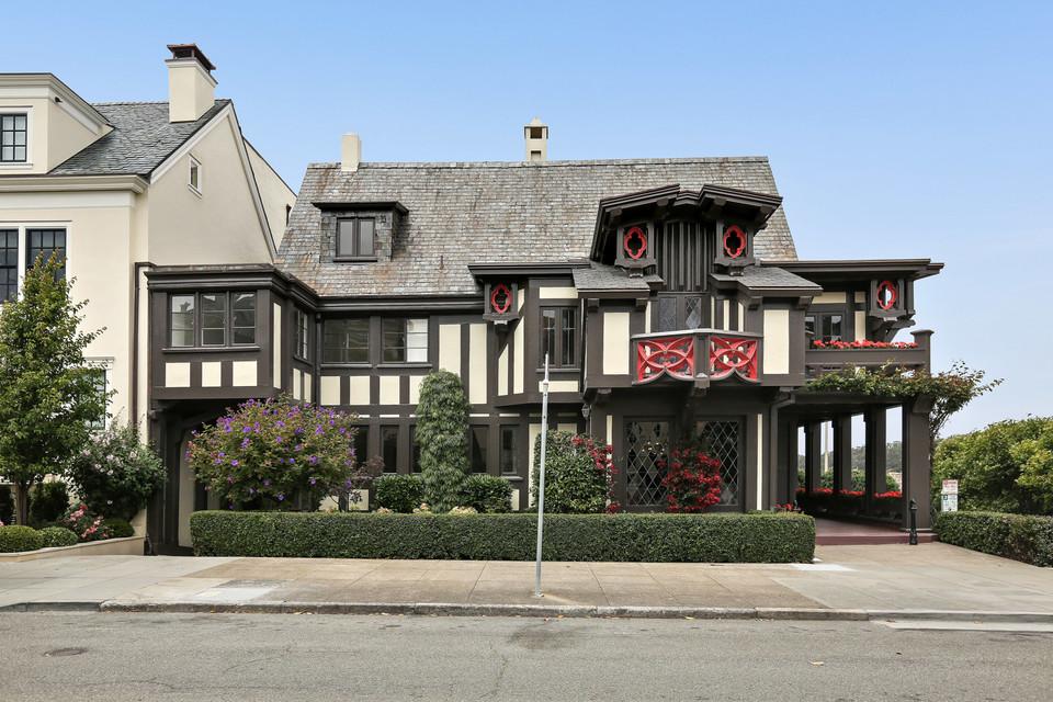 A black and red Tudor home.