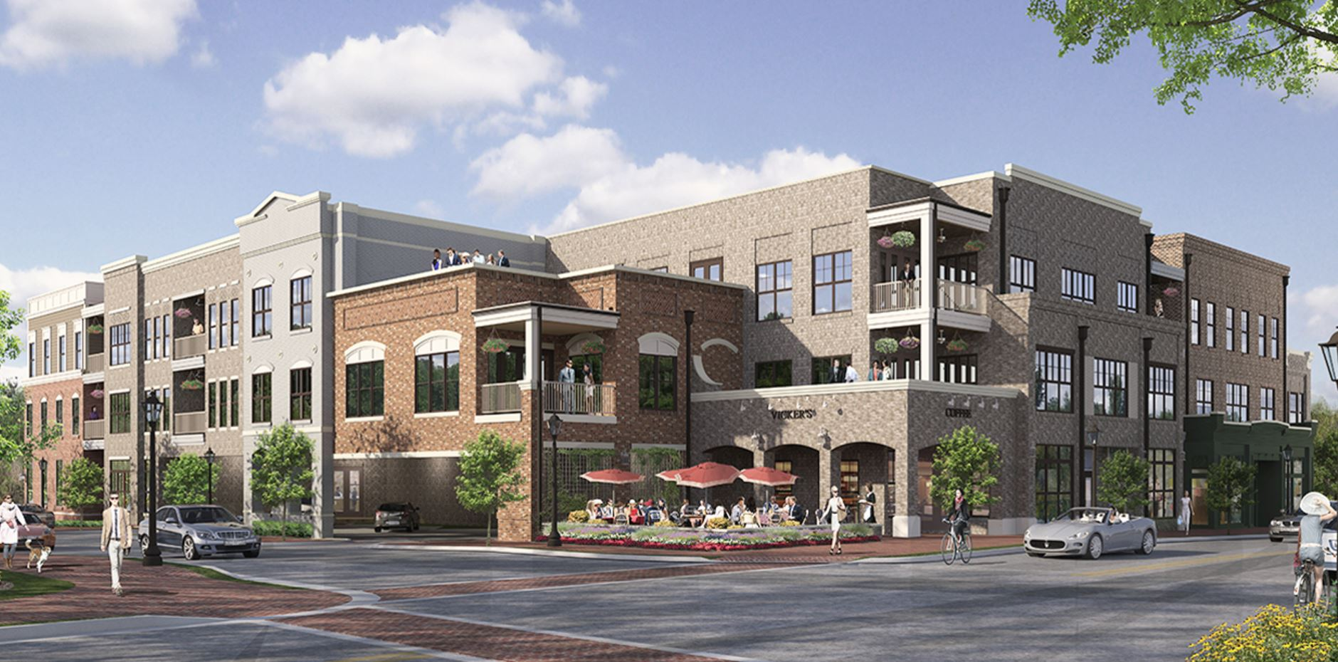 Three-story mixed-use development with residences above retail.