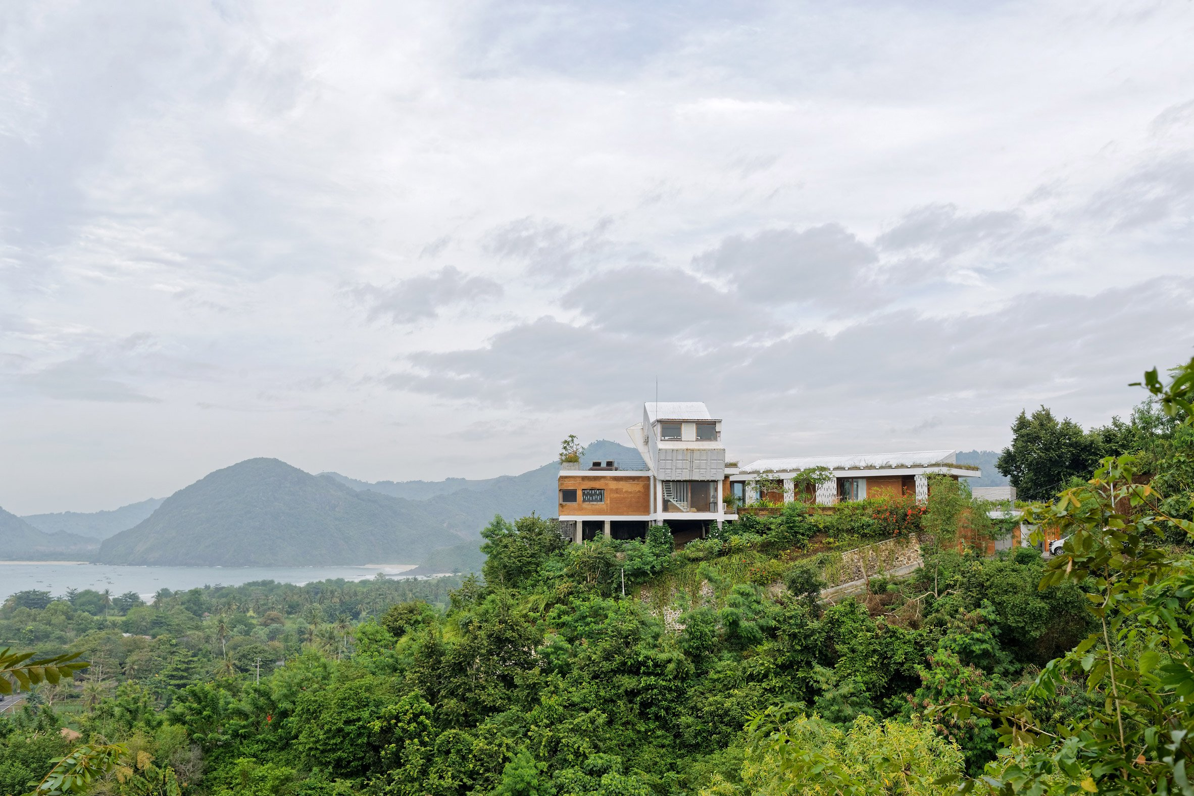Tilted shipping containers top scenic island home