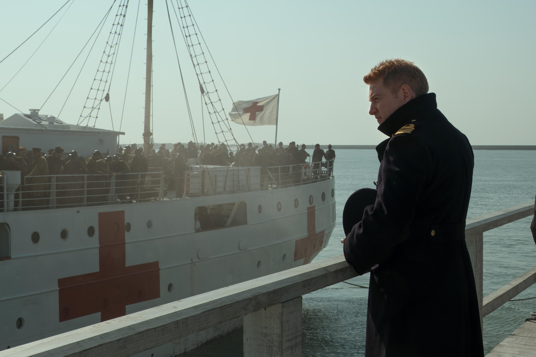 Dunkirk - Commander Bolton looking at medical ship