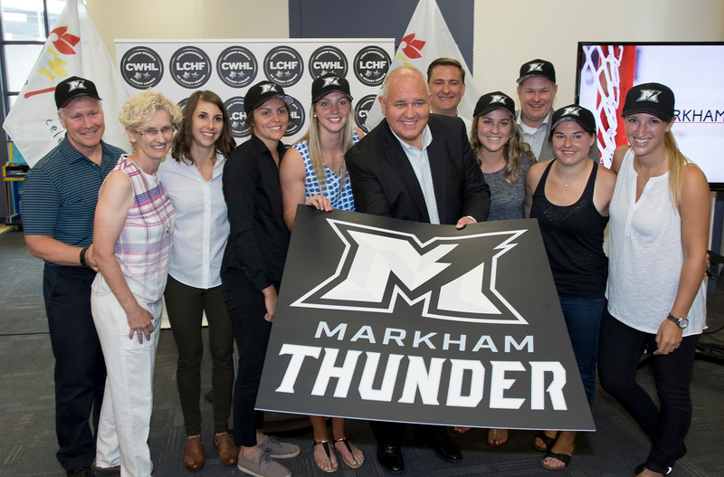 The mayor of Brampton, Commissioner Andress, and players and staff from the Markham Thunder unveil the new logo