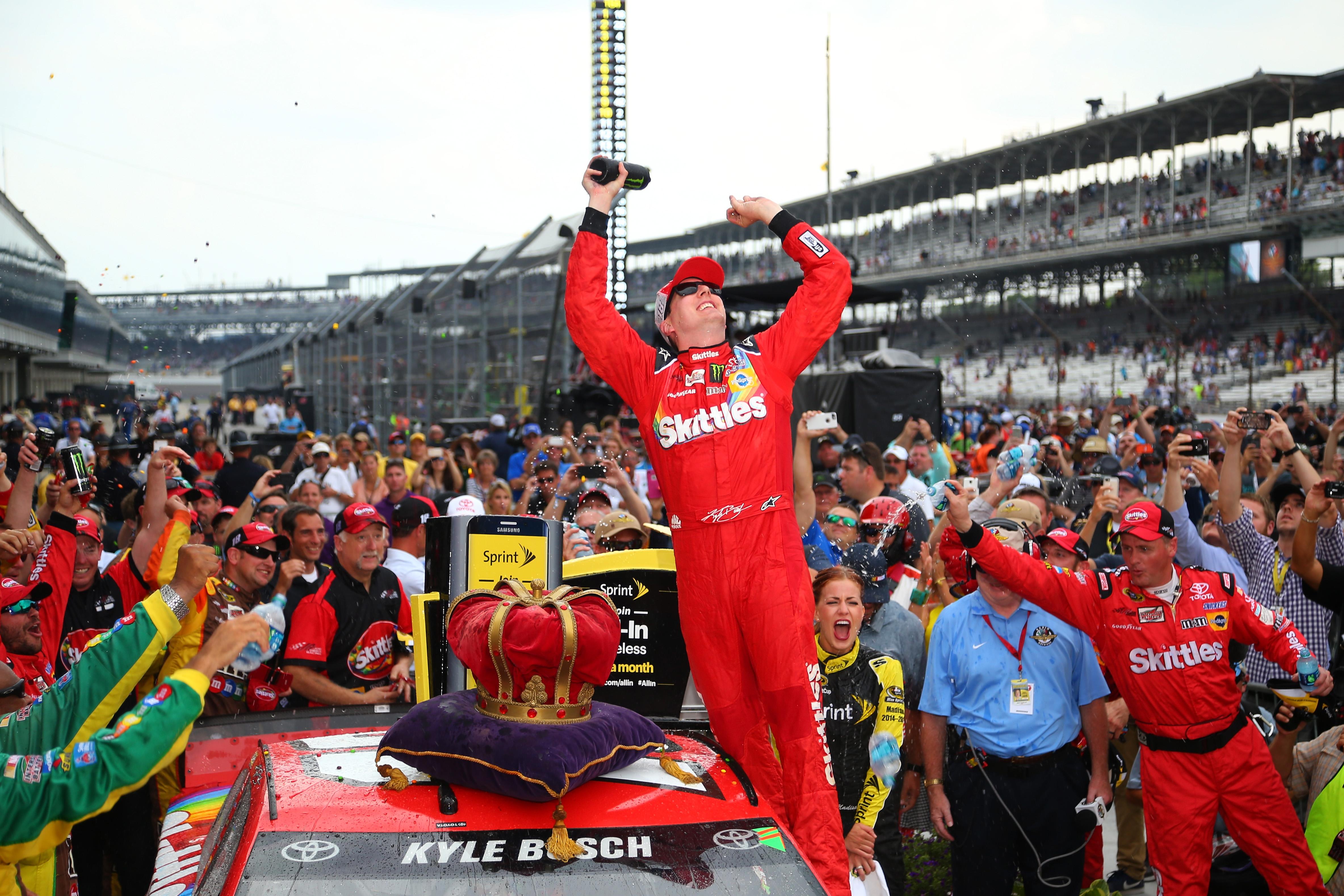 Kyle Busch celebrates winning the 2015 Brickyard 400 at Indianapolis Motor Speedway.
