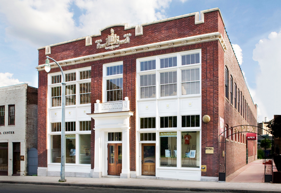 A two-story classical red brick commercial building.