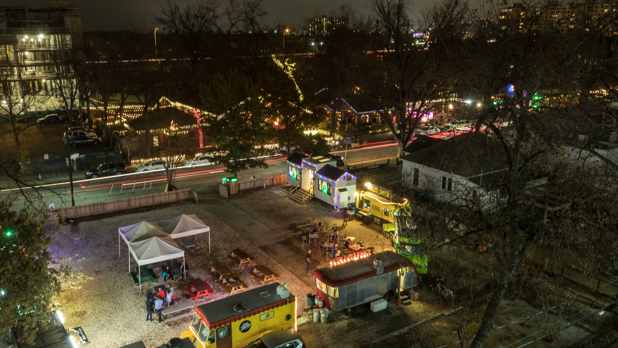 Overhead night shot of street, food trucks