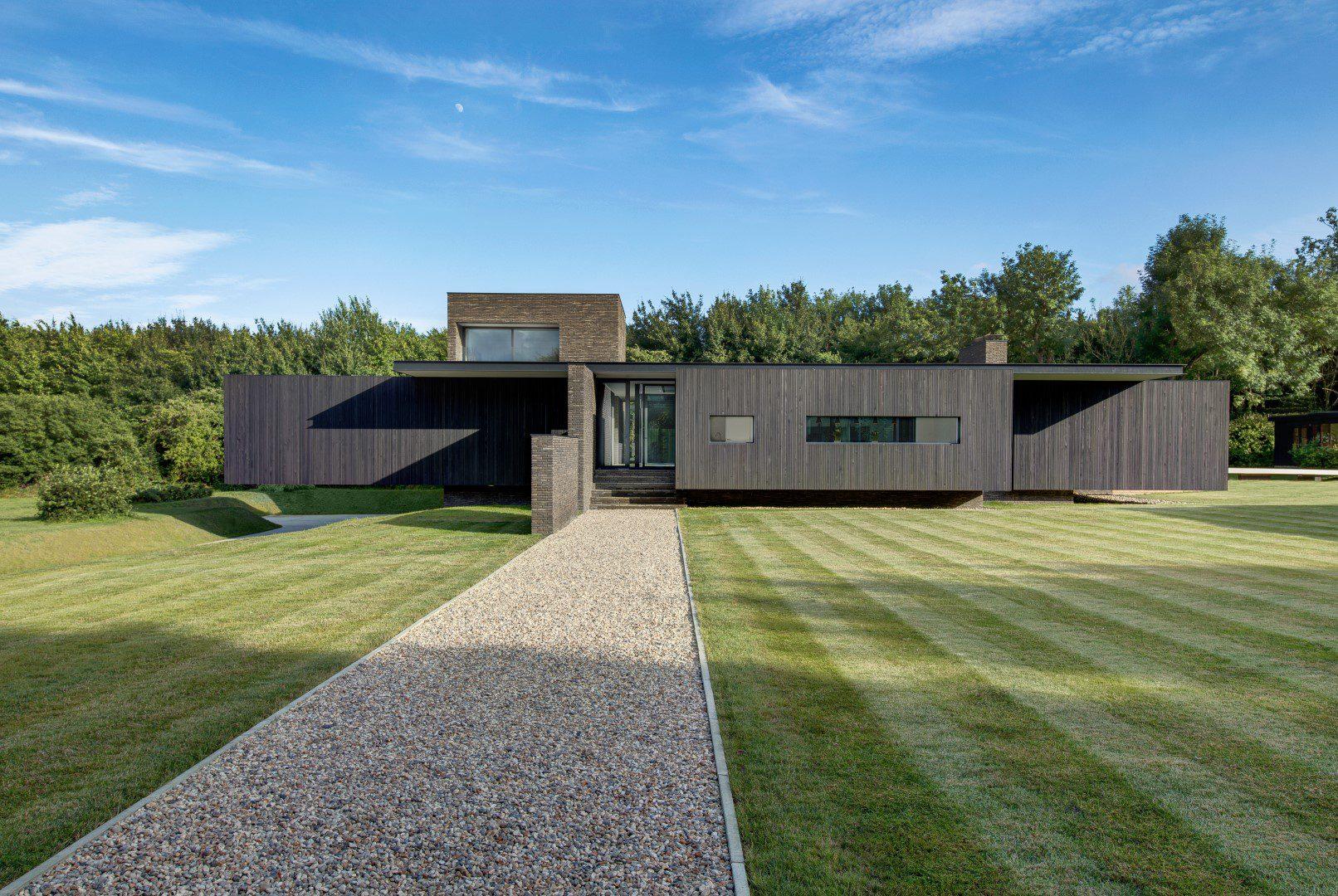 Sleek modern home looks like it's floating