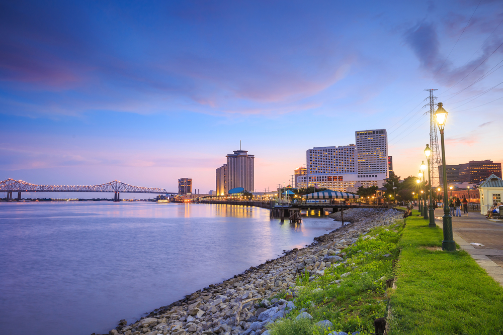 Riverfront view of New Orleans and a green space with high rise buildings