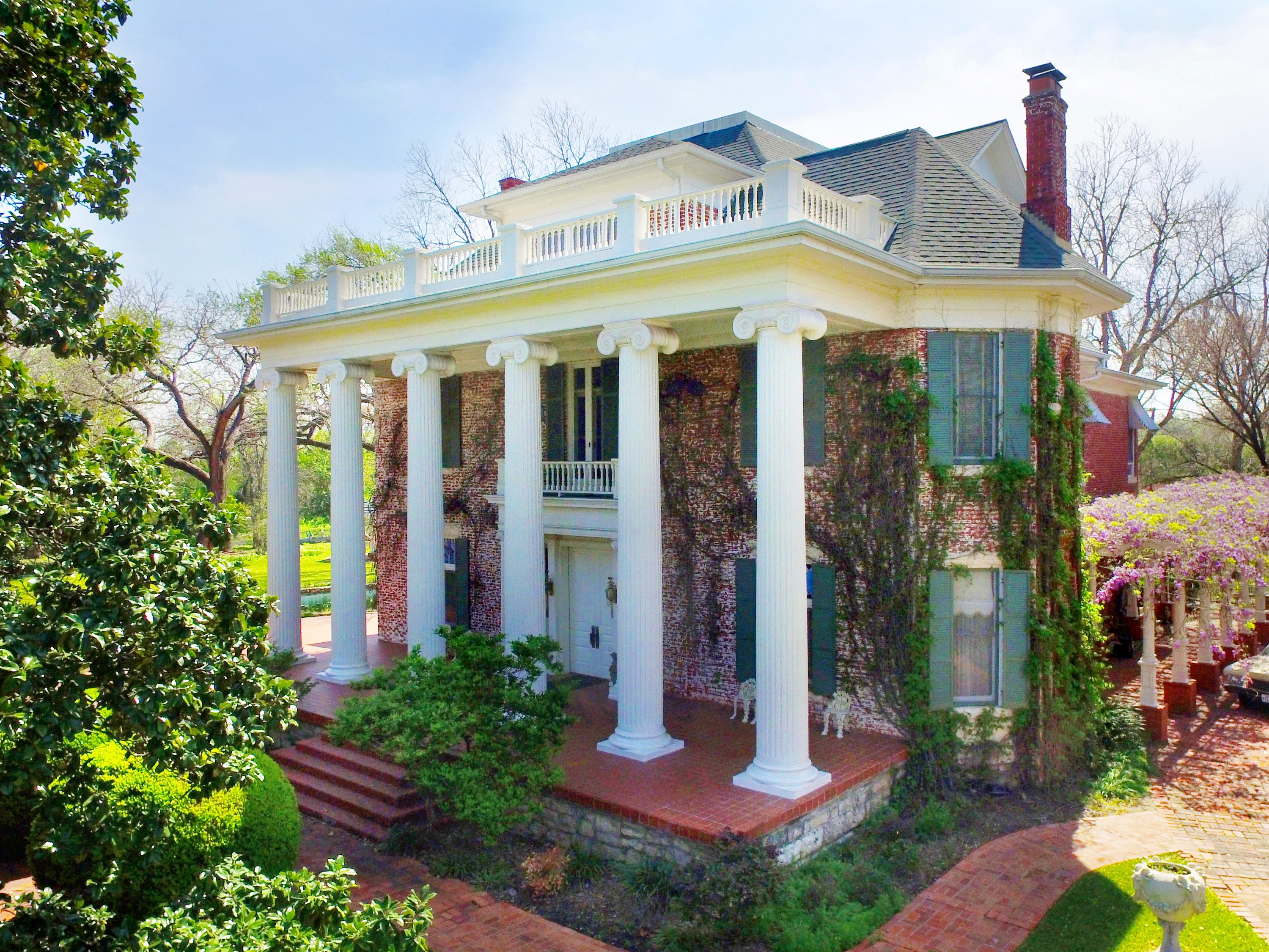 Three story red brick Colonial Revival