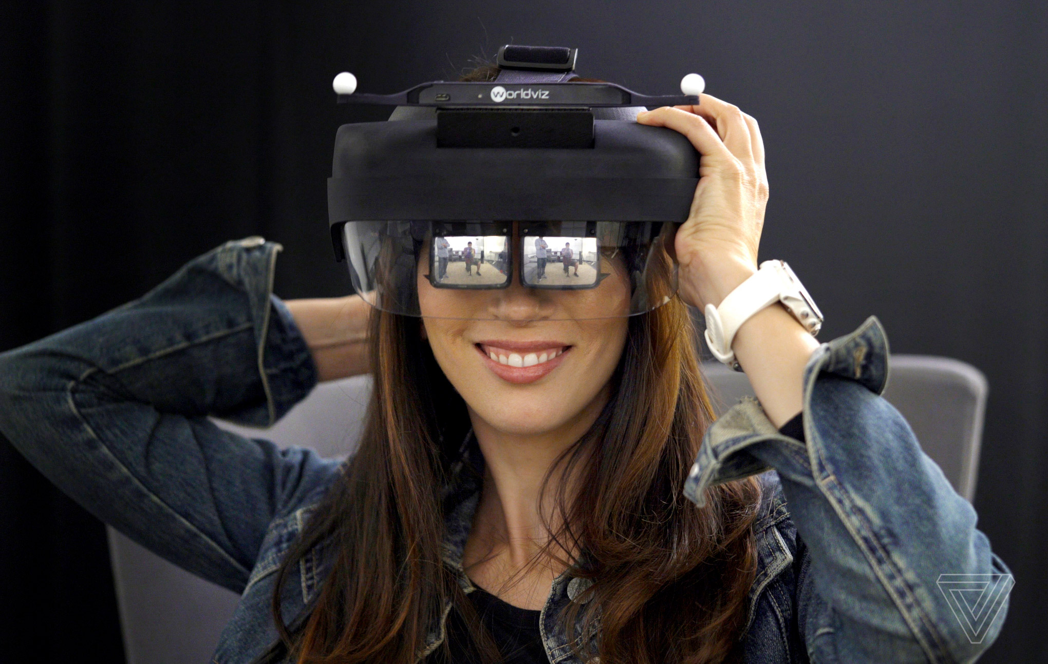 Woman wearing Avegant augmented reality headset