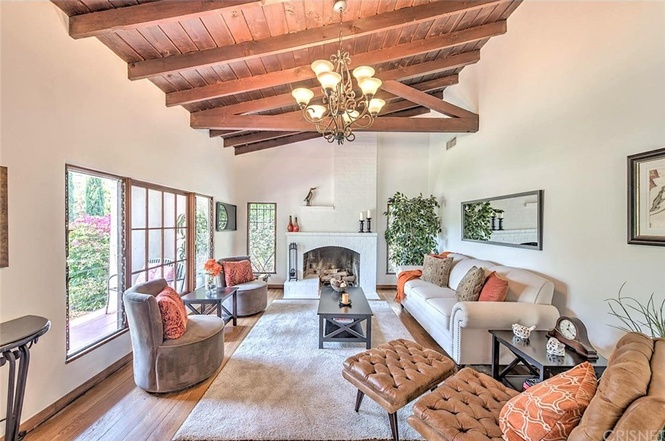 Living room with beamed ceilings