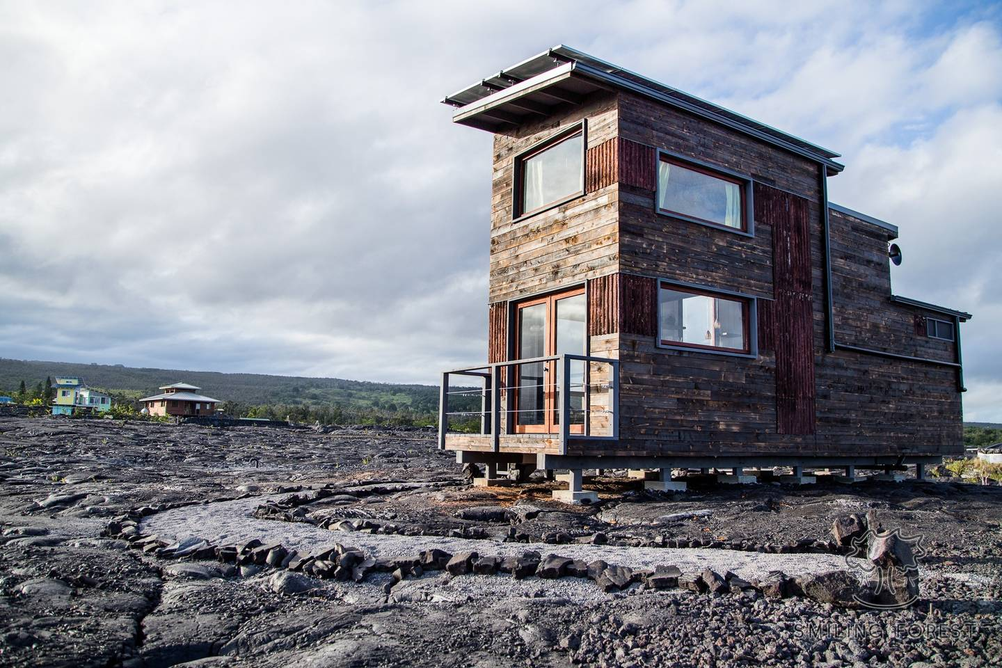Off-grid tiny house is located in the middle of a lava flow