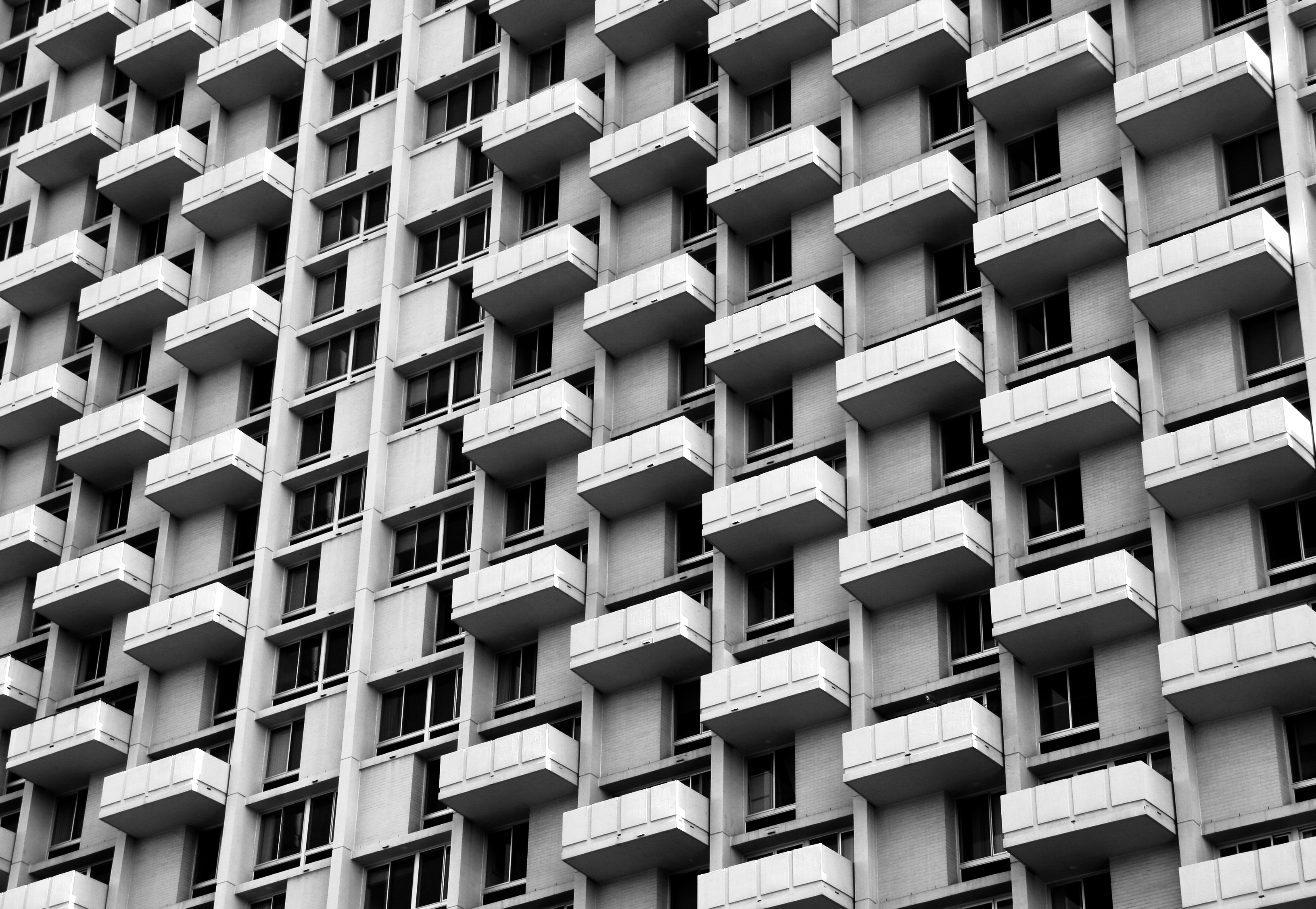 The facade of a building in Philadelphia. There are multiple windows with small balconies.