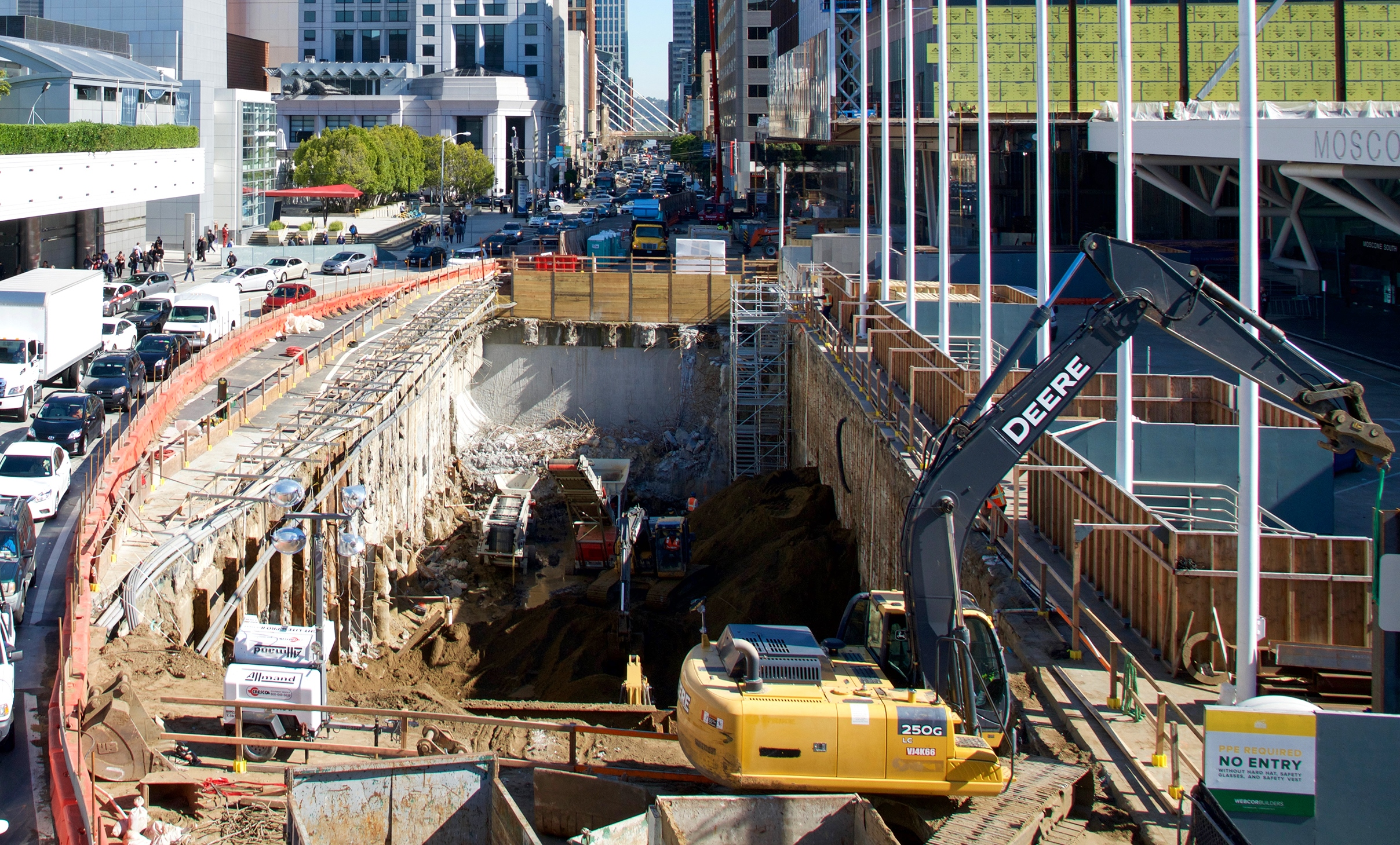 Workers digging a hole near Moscone Center.