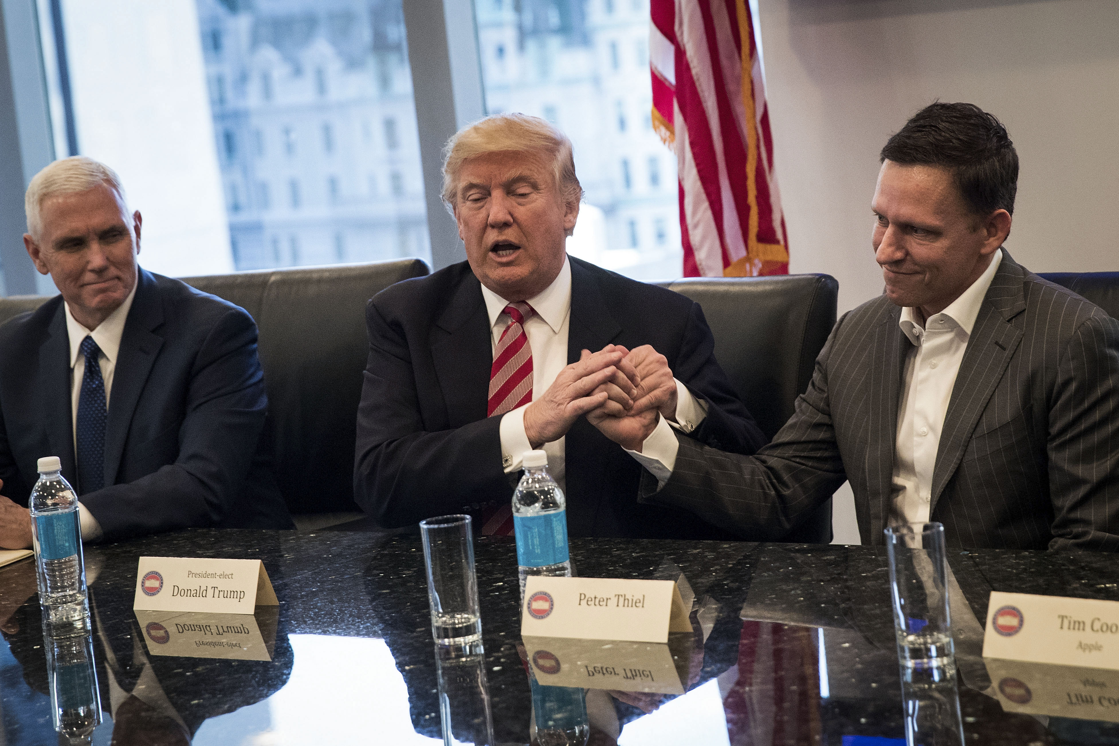 Donald Trump and Peter Thiel in an awkward handshake