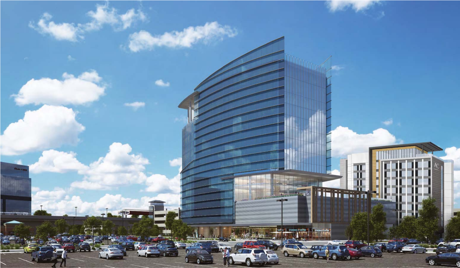 A curving glass office tower, next to a plain-looking hotel.