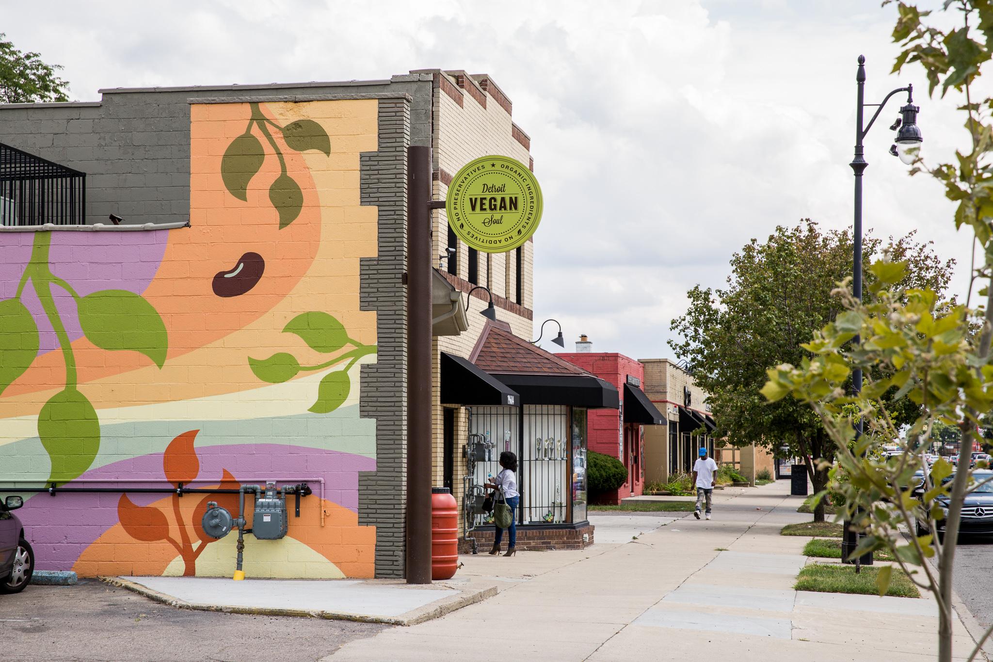 The colorful painted exterior of Detroit Vegan Soul in Grandmont Rosedale.